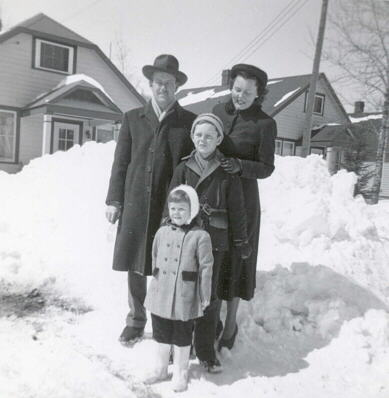 Dobie family standing in front of their house, Kearns Ont., 1949.